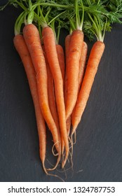Top view of bunch of carrots on  slate background