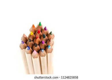 Top view of a bunch of colored pencils against a white background