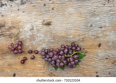 top view of bunch grape on old wood. copy space for text