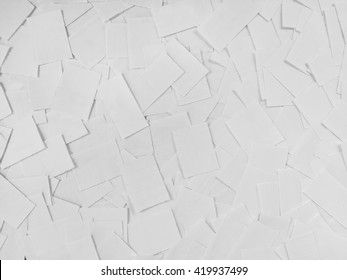 top view of a bunch of scattered small white sheets on the table