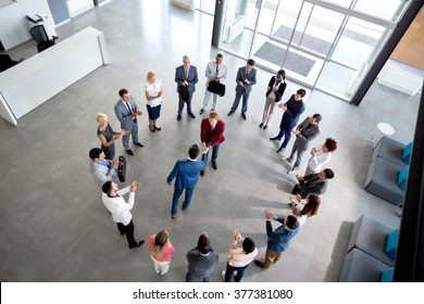 Top view of business arrangement and shaking hands of businessmen in center of circle