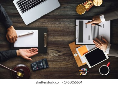Top view Business and lawyers discussing contract papers with brass scale on desk in office. Law, legal services, advice,  justice and law concept .