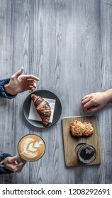 top view of a business meeting with coffee and croissant