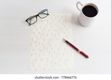 Top view business office. Coffee and decorative paper on white table.