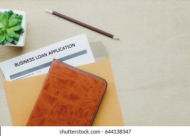 Top view business office desk background.The business loan application form pencil  letter and diary tree on wooden table background with copy space.