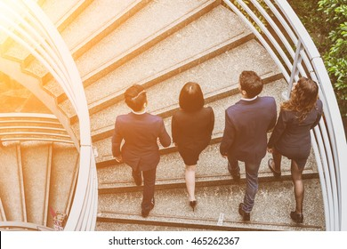 Top view of business people walking on staircase