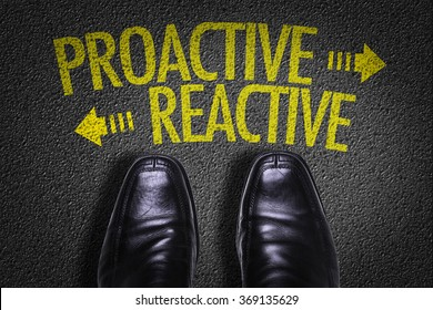 Top View of Business Shoes on the floor with the text: Proactive - Reactive