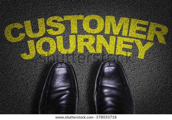 Top View of Business Shoes on the floor with the text: Customer Journey