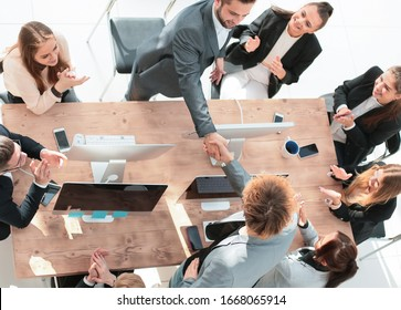 top view. business team applauding at a work meeting