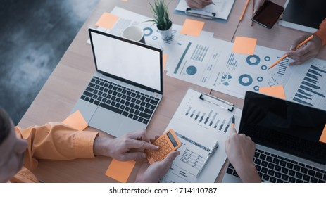 Top view of businessman and businesswoman hands holding stickers for note on table. Business and agenda concept