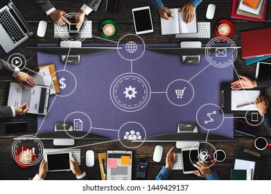 Top view of businessman Group of Multiethnic Busy People meeting with other in modern office with laptop computer, smartphone, tablet, coffee and document on table. with VR icons