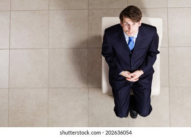 Top view of businessman sitting on chair