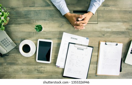 Top view businessman submit job applications to managers and committees, recruiting departments of company in interview room, concepts of new job applications, employment and recruitment personal.
