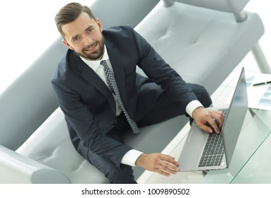 Top view of businessman working on laptop in office