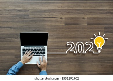 Top view businessman working on laptop computer, With connecting networking creative light bulb idea 2020 new year