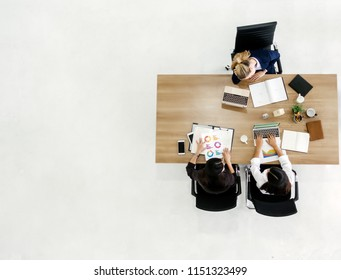 top view of businesswoman discussing working at table in office.