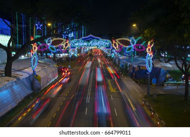 Top view of busy street lightened up with colorful decorative lightings with people shopping walking on both sides during Ramadan holy month of Muslim in Singapore