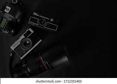 Top view of Cameras.Olympus trip 35 35mm Camera, Kodak Instamatic 11, Canon 6D camera body  EF 100mm f / 2.8L Macro IS USM lens Canon Lens State of São Paulo, Brazil-23/4/2020.