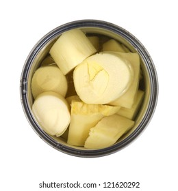 Top view of a can of processed hearts of palm on a white background.