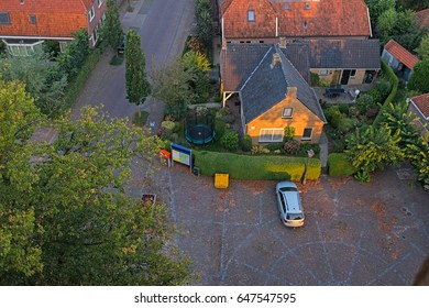 Top view of car parked on square in dutch rural village.