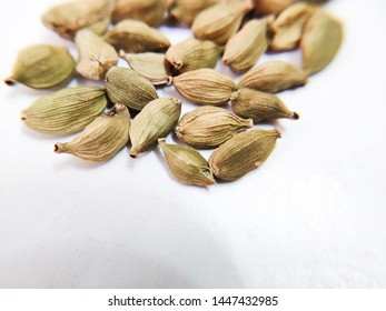 top view cardamom isolated on white background ,seeds skin texture,