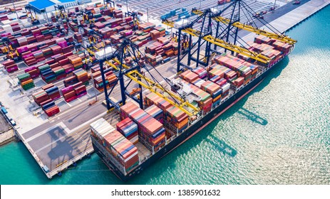 Top view cargo ship, loading and unloading goods at the deep sea port