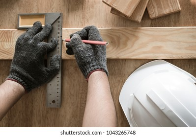 top view of carpenter measuring and writing on wood with copy space background