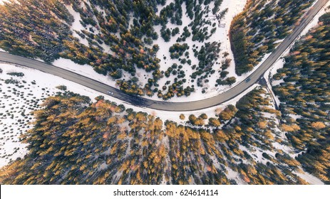 Top view of cars on a curvy road. Aerial drone shoot of a street in the mountains.