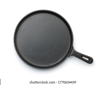 Top view of cast iron crepe pan isolated on white