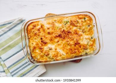 Top view of cauliflower, broccoli and cheese casserole in rectangular shape glass baking dish. - Shutterstock ID 1933841399