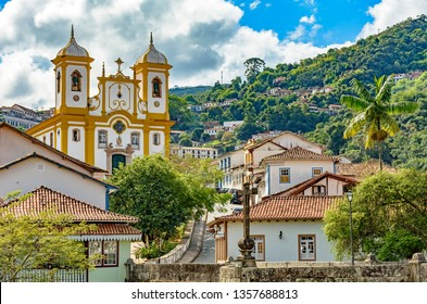 Top view of the center of the historic Ouro Preto city in Minas Gerais, Brazil with its famous churches and old buildings with hills in background