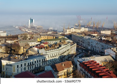 top view of the center of the historical part of Odessa and the Odessa sea port on a sunny day with fog.
