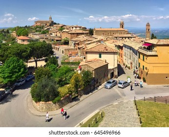 Top view of the central part of medical Montalcino with tourists on a sunny spring day.  Tuscany, Italy. April 2017.