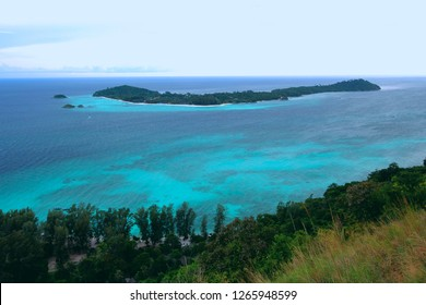 Top view of Chado Cliff view point on Adang island in the morning, From here you can see Koh Lipe or Lipe Island and turquoise blue sea water. Satun Province, Thailand.