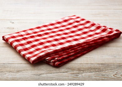 Top view of checkered napkin tablecloth on white wooden table. Unique perspectives horizontal