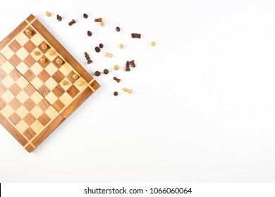 Top view of chess board with chess pieces on white background