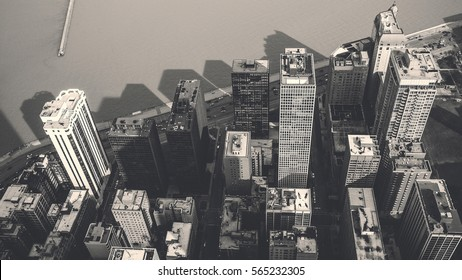 Top view of Chicago city - looking down from high angle with shadow of building on the ocean - black and white tone