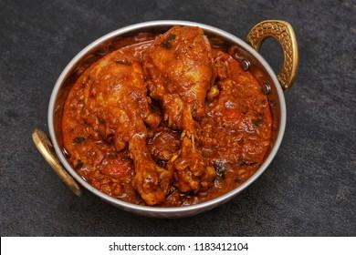 Top view of chicken Kolhapuri or Hyderabadi Lagan Ka Murgh curry mildly hot and spicy recipe Punjab, India.Popular side dish in North Indian non-vegetarian cuisine prepared using Garam Masala.