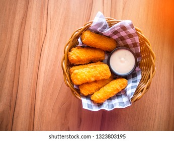 Top view chicken nuggets with sauces on Wooden basket.golden chicken nuggets.