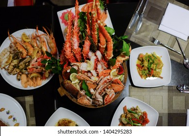 Top view , Chilled seafood in bucket , king crabs ,Tiger prawns and blue crabs