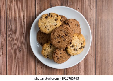 A top view of chocolate chip cookies on a wooden table