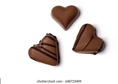 top view of chocolate heart shaped candies isolated on white