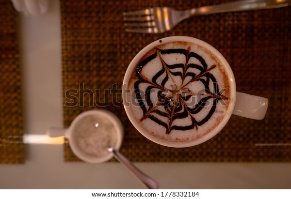 top-view-chocolate-latte-art-600w-177833