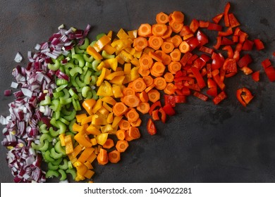 Top view chopped fresh vegetables on dark background