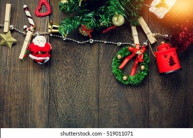 Top view Christmas background.decoration,ornaments,lamp and jewelry clothesline on wooden table  with copy space.