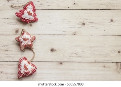 Top view of christmas decorations over wooden background