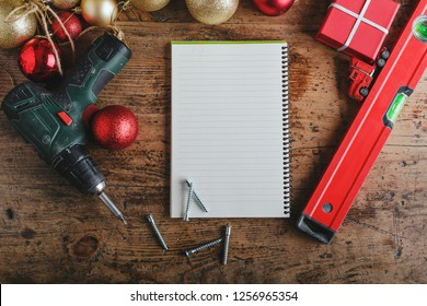 Top view for Christmas decorations with space for your wishes, wooden table top for builders, mechanics, repairers. place for text. Christmas background
