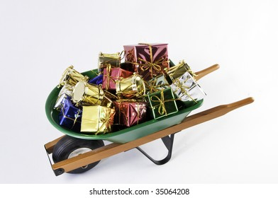 Top view of Christmas presents in a green wheel barrel.It is on a white background.