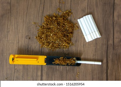 Top view of cigarette rolling machine, cigarette filter and tobacco stack