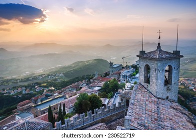 Top view of city filled with sunset light, San Marino.